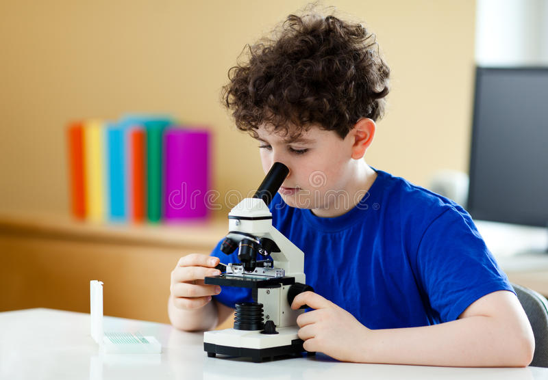 Download Boy using microscope stock photo. Image of biology, male - 19821046