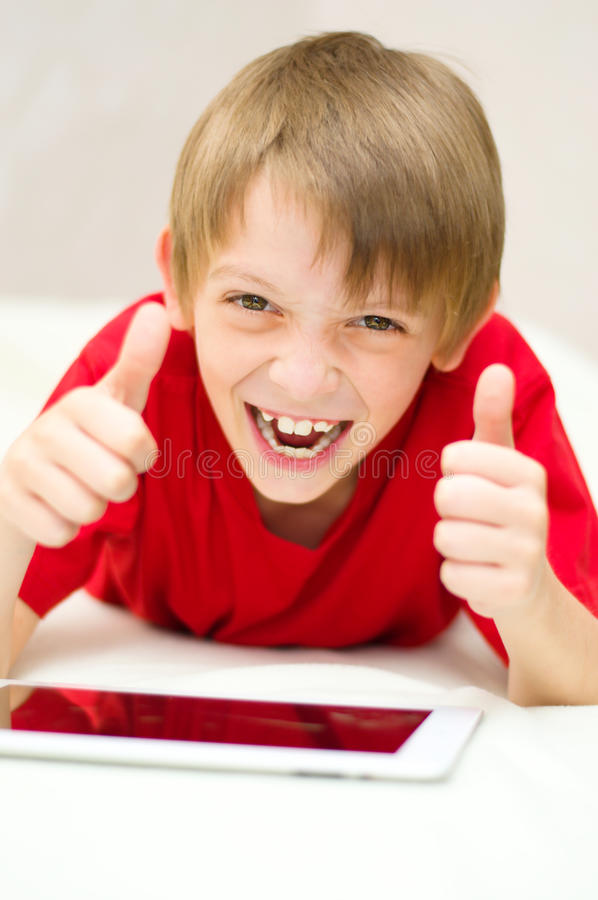 Download Boy using tablet stock photo. Image of looking, casual - 33123780