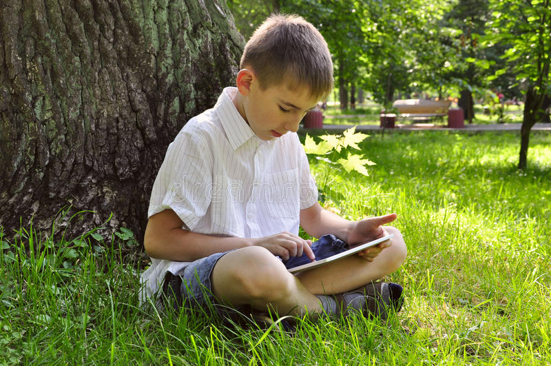 Boy using tablet pc stock photo