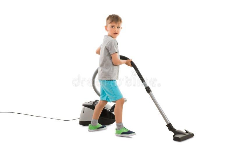 Boy Using Vacuum Cleaner royalty free stock image