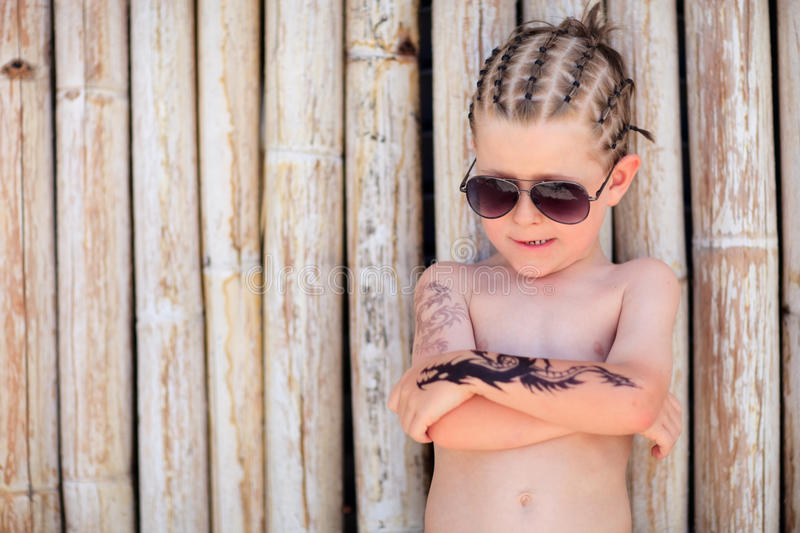 Boy on vacation. Cute 5 years old boy with african style hair and henna tattoo royalty free stock images