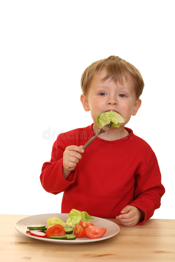 Boy and vegetables royalty free stock photos