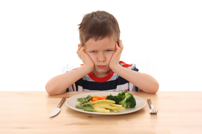 Boy and vegetables royalty free stock photography