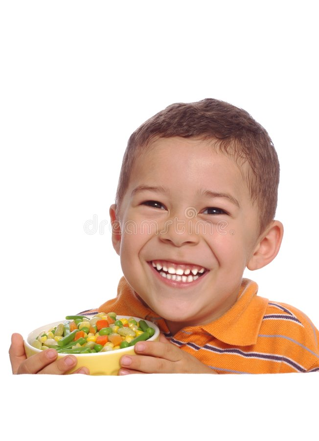 Boy and veggies. Smiling boy holding a bowl of mixed vegetables stock photo