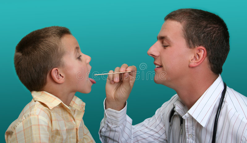 Boy visiting the doctor stock image