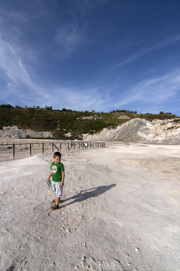 Download Boy at volcanic crater stock photo. Image of crater, geologic - 25294848