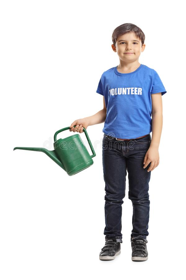 Boy volunteer with a watering can royalty free stock photos