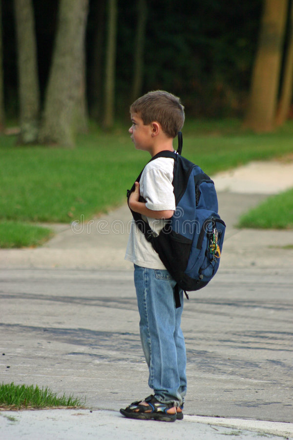 Boy Waiting On Bus Stock Photo