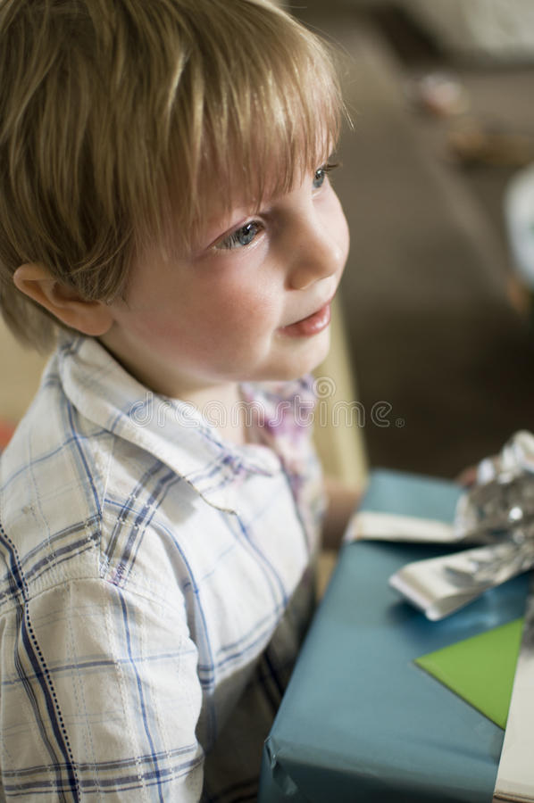 Boy waits with present stock images