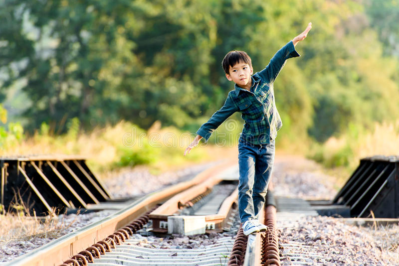 Boy walk on the railway royalty free stock images