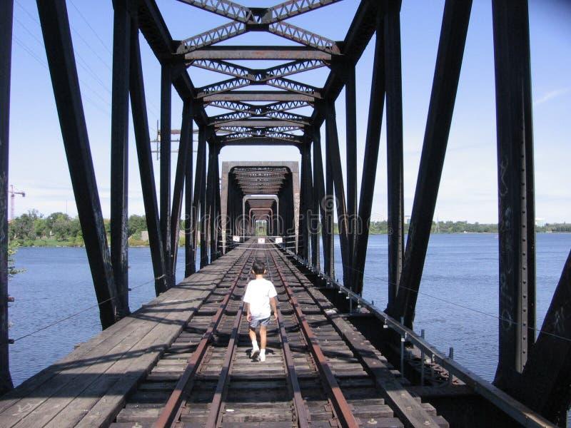 Boy Walking on Train Tracks royalty free stock photography
