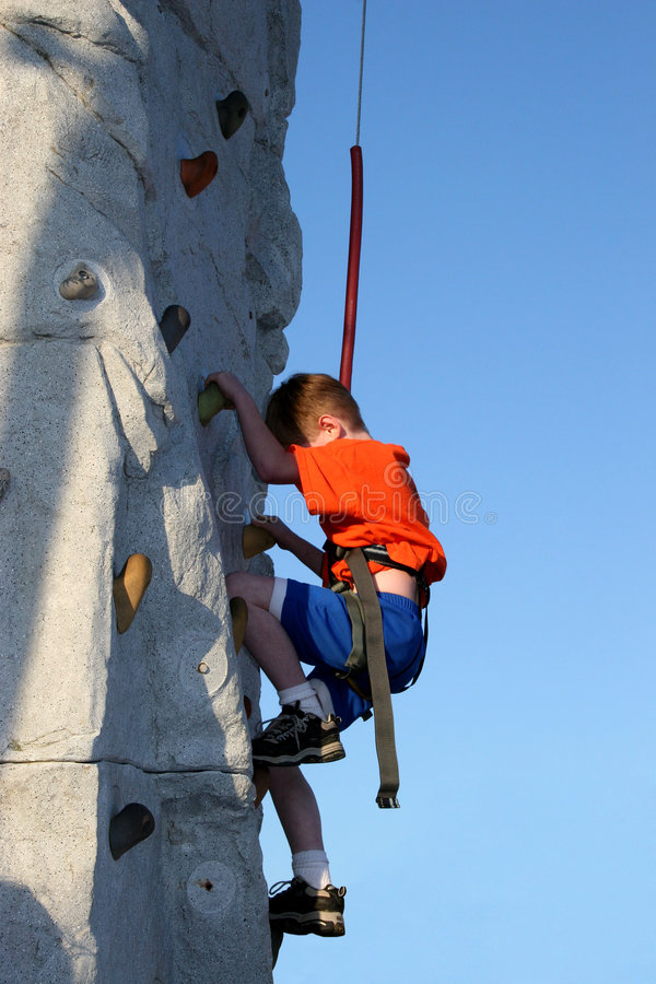 Free Boy Wall Climbing Outdoors Royalty Free Stock Image - 116816