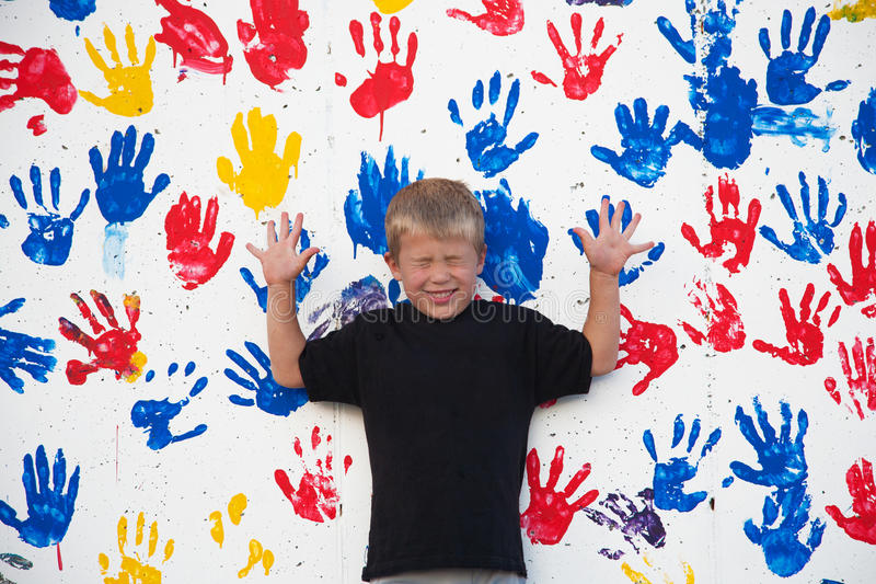 Download Boy By Wall With Handprints Stock Image - Image of messy, wall: 20331401