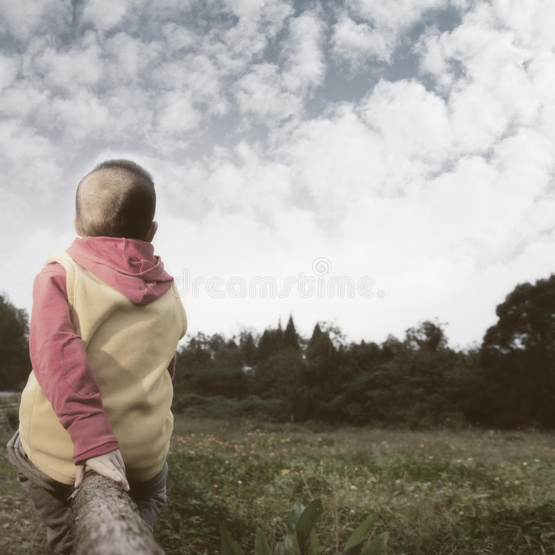 Free Boy Watching Far Away Royalty Free Stock Images - 61846559