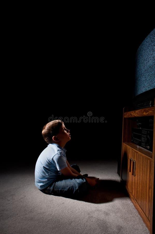 Boy watching tv stock image