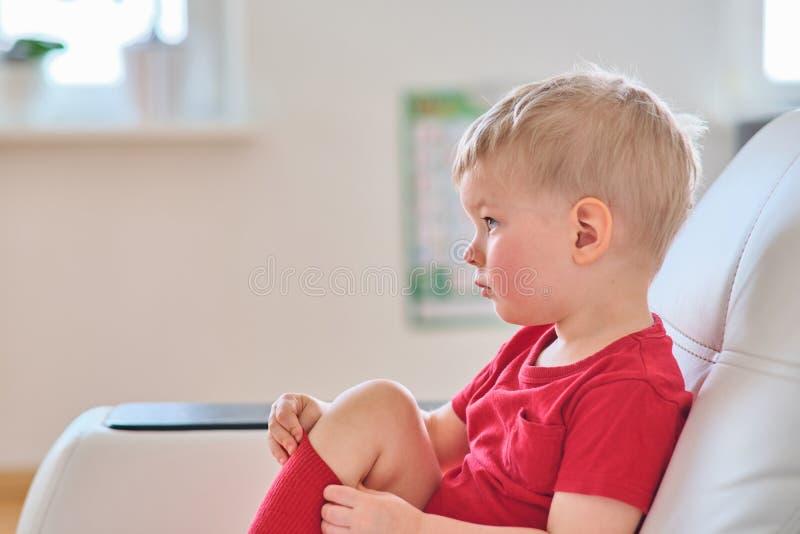 Boy watching tv stock photos