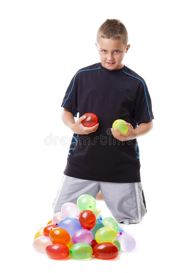 Boy With Water Balloons Royalty Free Stock Photo