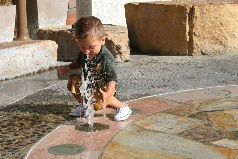 Boy & Water Fountain Royalty Free Stock Photo