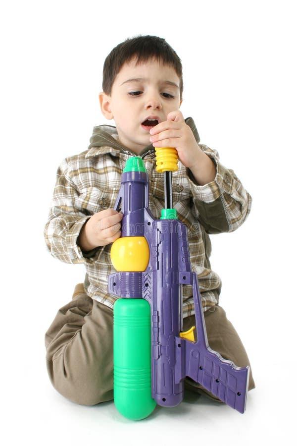 Boy with Water Gun royalty free stock photos