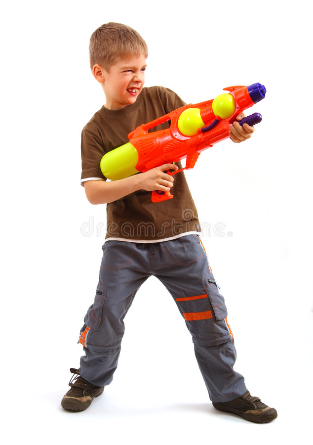 Boy with water gun stock photography