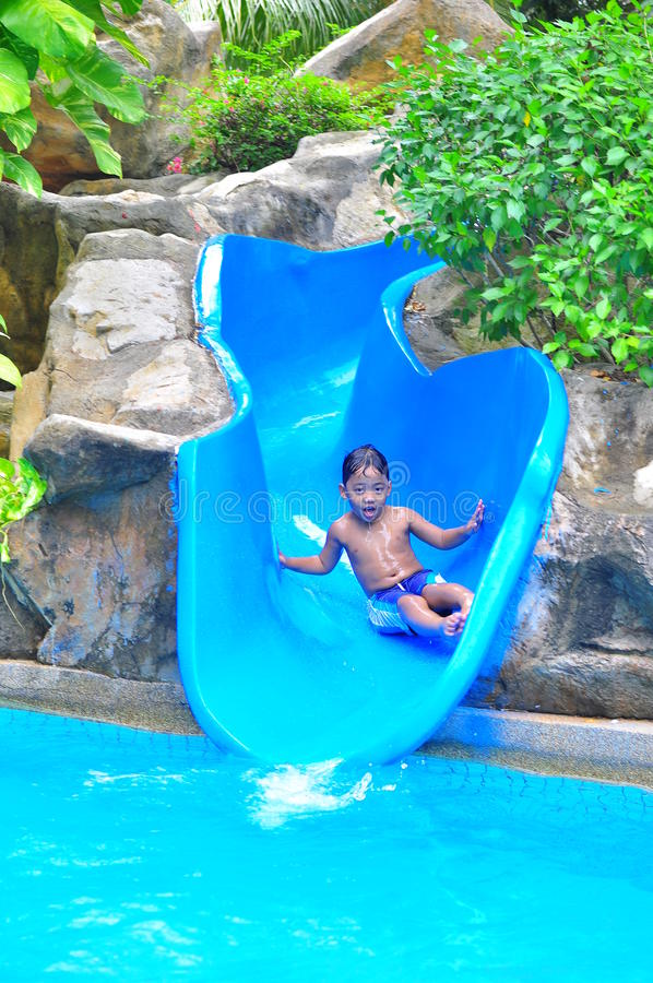 Download A boy on a water slide stock photo. Image of adventure - 20184574