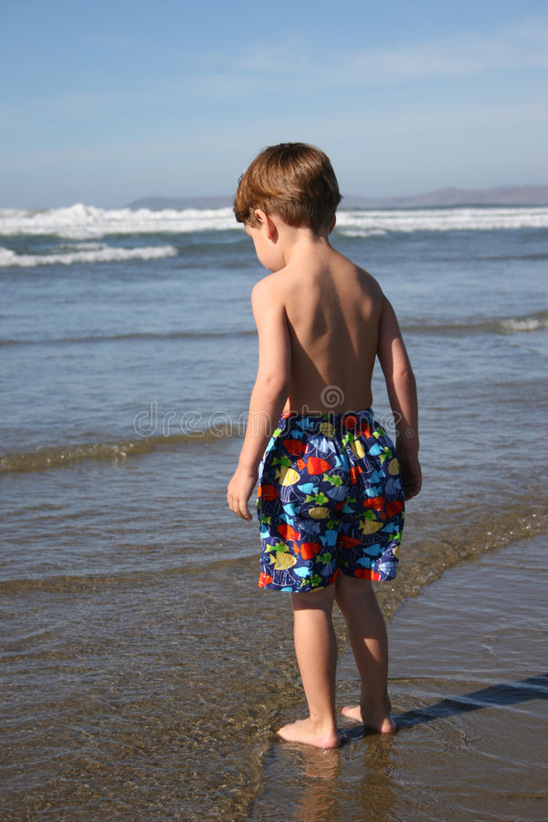 Boy at the Waters Edge royalty free stock image