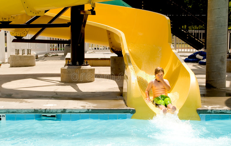Boy on a Waterslide stock photography