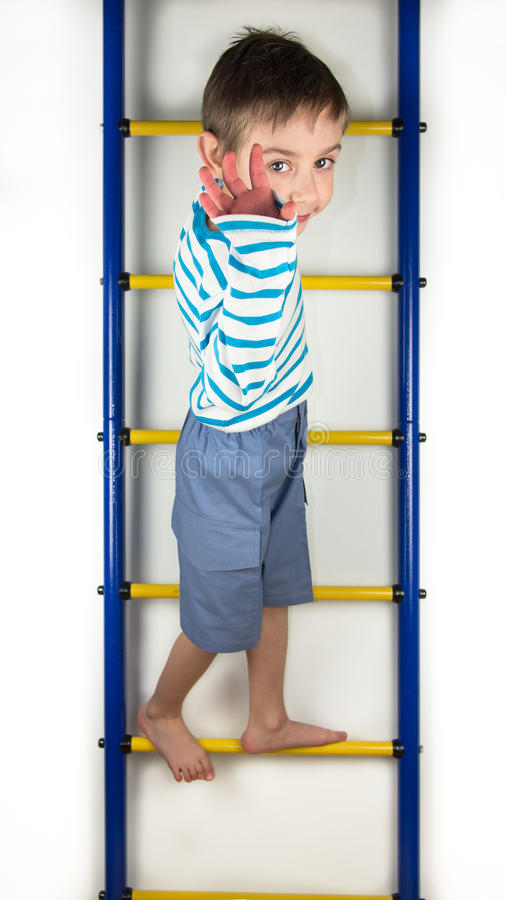 Boy waving hand stock photos