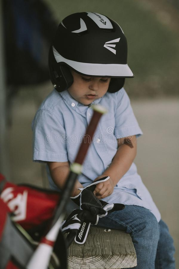 Boy Wearing Black and White Baseball Helmet and Gloves royalty free stock image