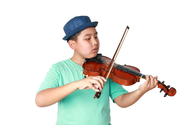 A boy in a blue hat playing the violin stock photo