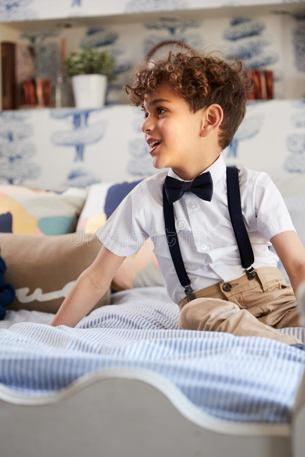 Boy Wearing Bowtie And Suspenders Getting Ready For Fathers Wedding stock photos
