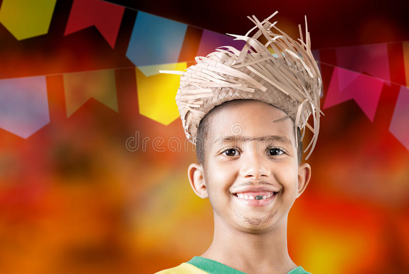 Boy wearing caipira clothes for the Brazilian Junina Party (Festa Junina) royalty free stock photos