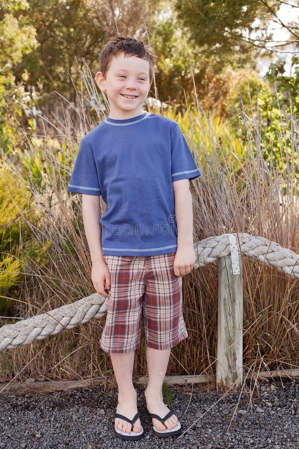Boy wearing flip flops. Seven year old boy wearing rubber Flip Flops, also known as Thongs stock photography