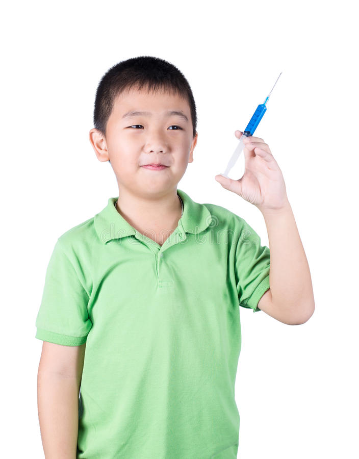 A boy wearing green t-shirt, holding syringe in his hand royalty free stock photo
