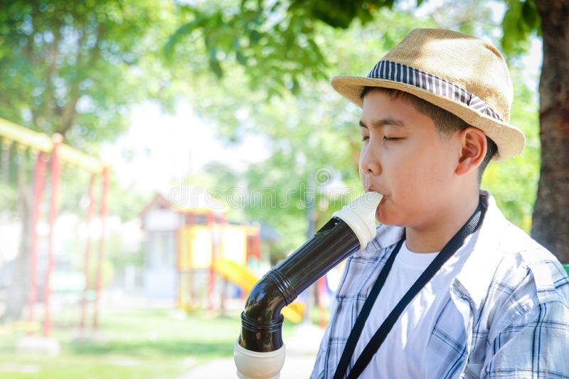 Boy wearing a hat playing classical music stock photos