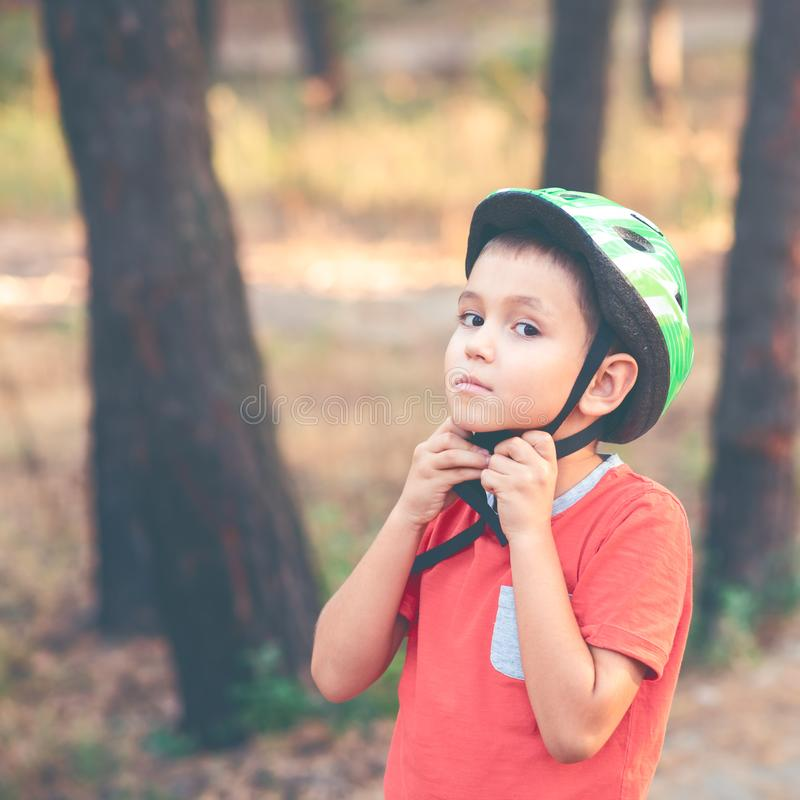 A boy wearing a helmet for cycling stock image