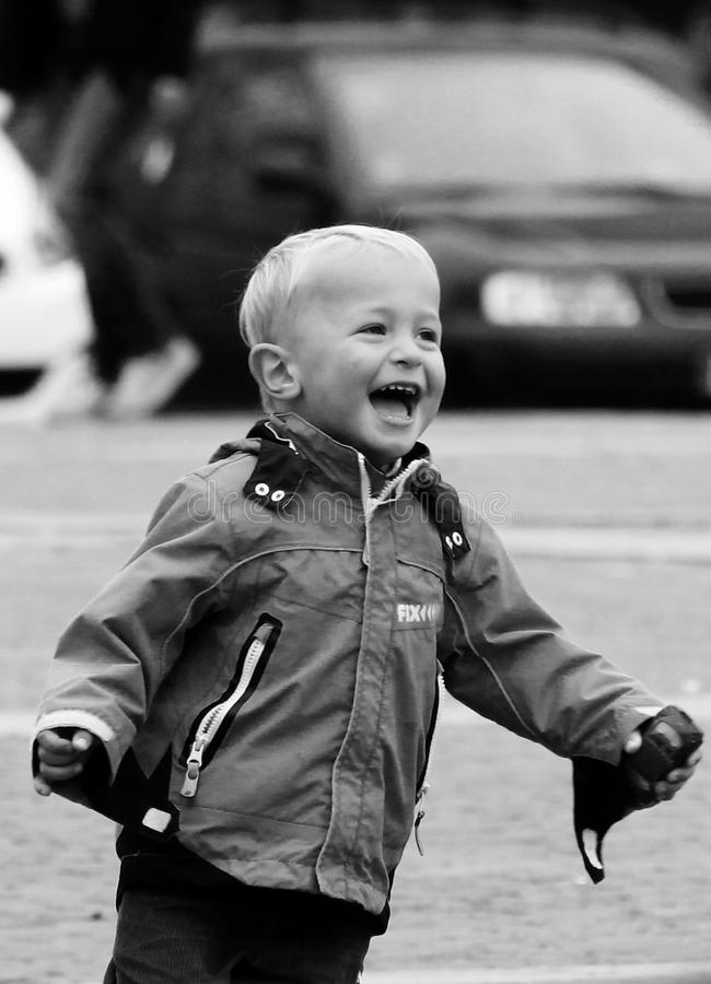 Boy Wearing Jacket on Street in Grayscale Photography royalty free stock images