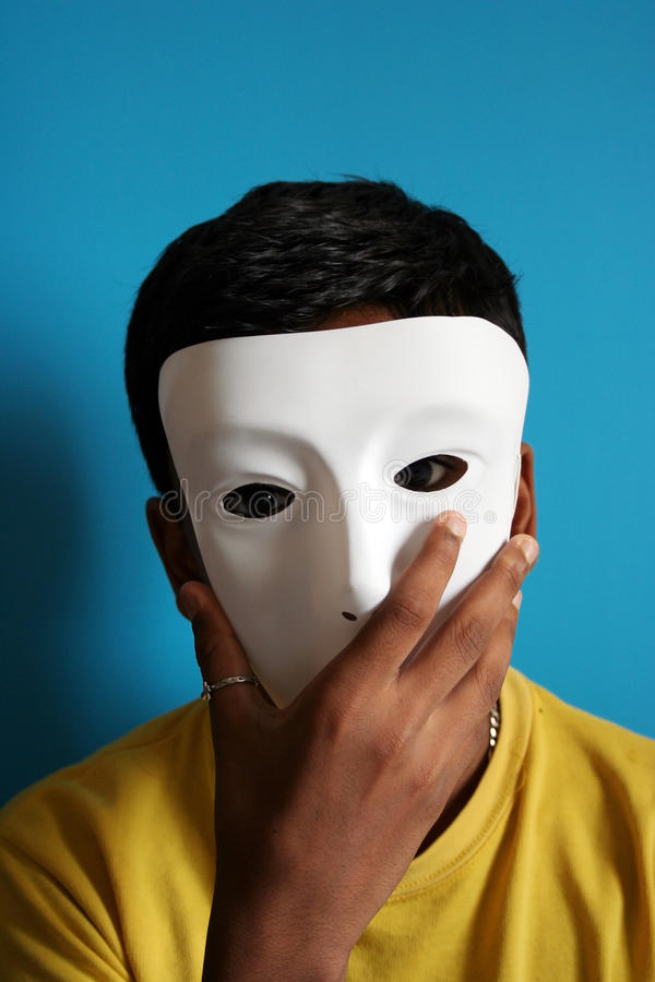 Boy wearing a mask stock photos