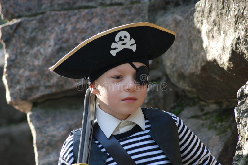 Boy wearing pirate costume royalty free stock photos