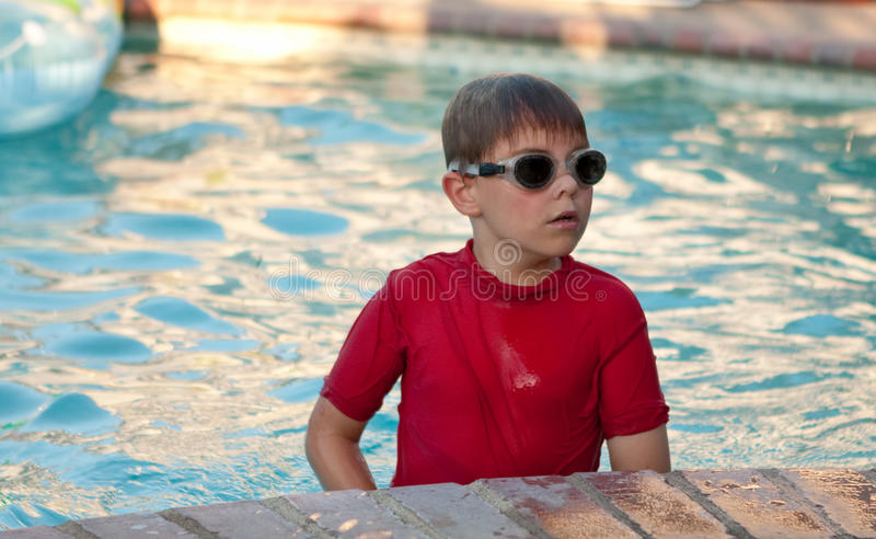 Boy Wearing Red Shirt And Goggles In Pool Stock Images