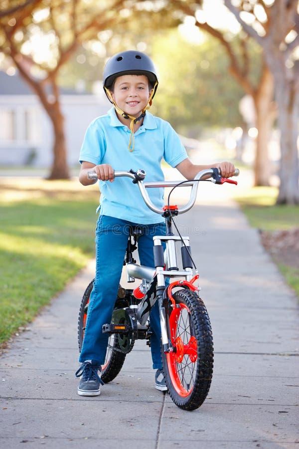 Download Boy Wearing Safety Helmet Riding Bike Stock Photo - Image: 29683658