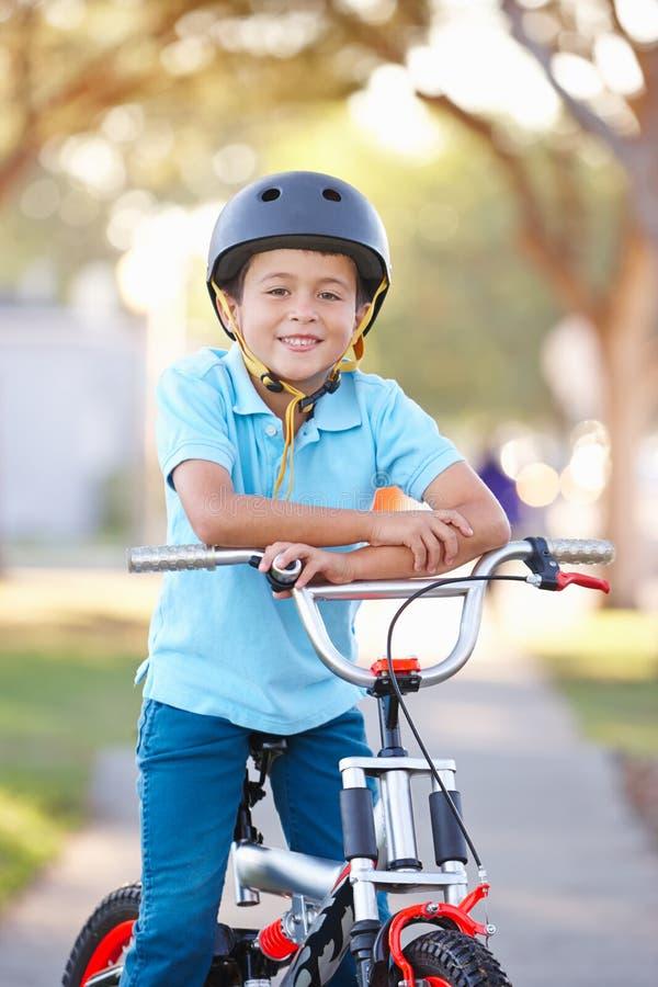 Download Boy Wearing Safety Helmet Riding Bike Royalty Free Stock Photos - Image: 29683668