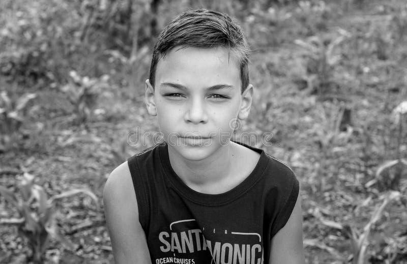 Boy Wearing Santamonic-printed Sleeveless Shirt stock photos