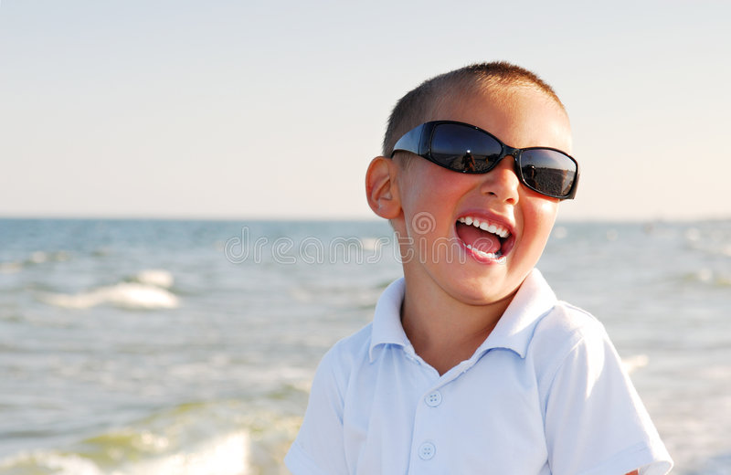 Download Boy Wearing Sunglasses By Sea Stock Photo - Image: 6409570