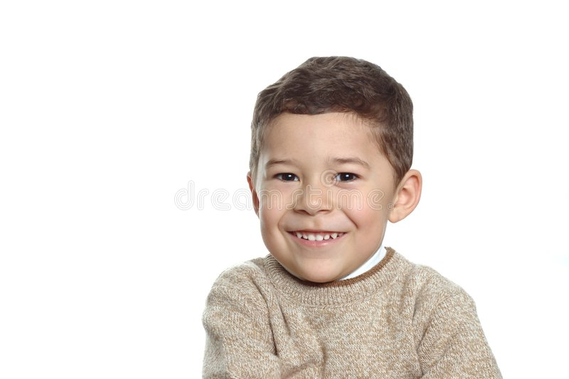 Boy wearing a tan sweater. 5 year old Hispanic boy wearing a tan sweater, isolated on a white background with copy space royalty free stock images