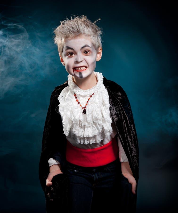 BOy wearing vampire for halloween royalty free stock photo
