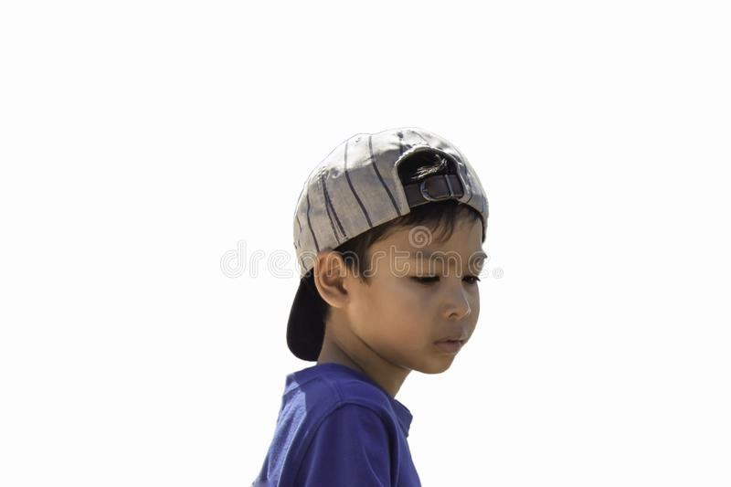 A boy wearing a winter jacket and hat standing on the white background stock images