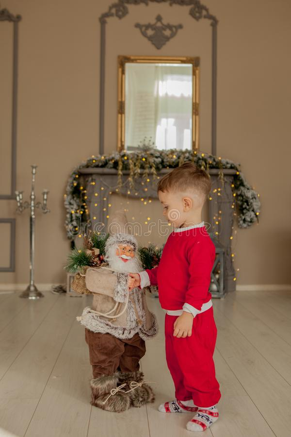 Boy is welcome with santa. Holidays, present, childhood, happiness concept stock image