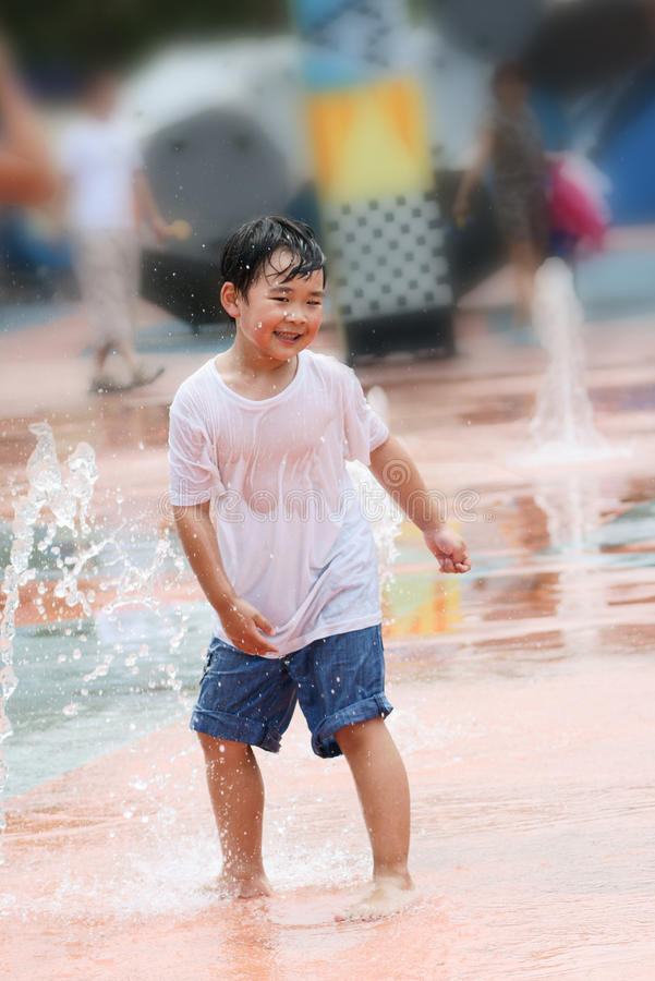 Free Boy Wet And Laughing In A Fountain Square Royalty Free Stock Photography - 26073677