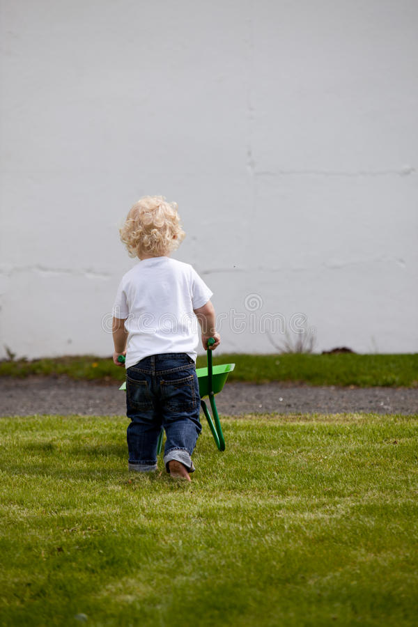 Boy with Wheelbarrow royalty free stock photo